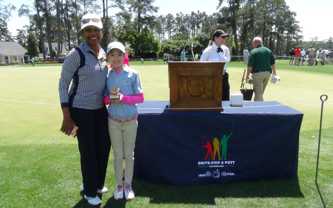 Victoria Matthews with Dr. Condoleezza Rice after Winning Longest Drive at 192 Yards